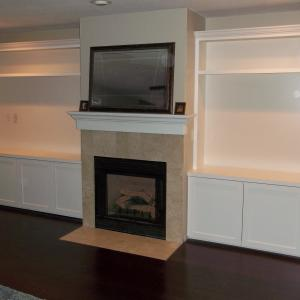 Bookcase over cabinets in family room